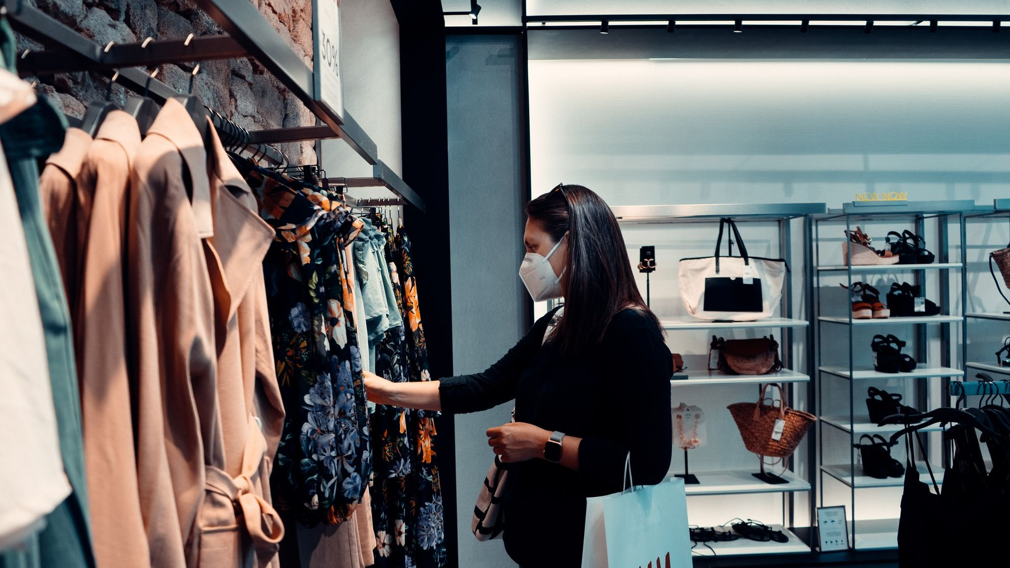 A woman shopping for garments during COVID-19 outbreak.