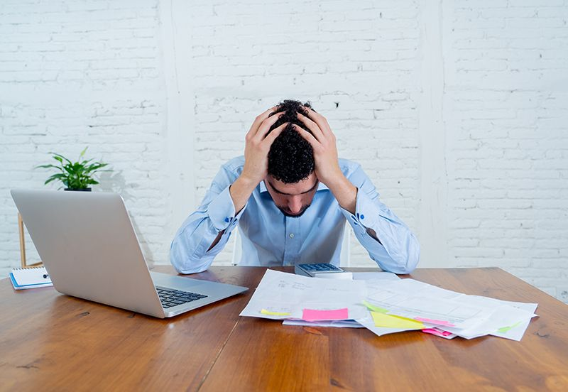 A small business owner stressed due to bookkeeping.