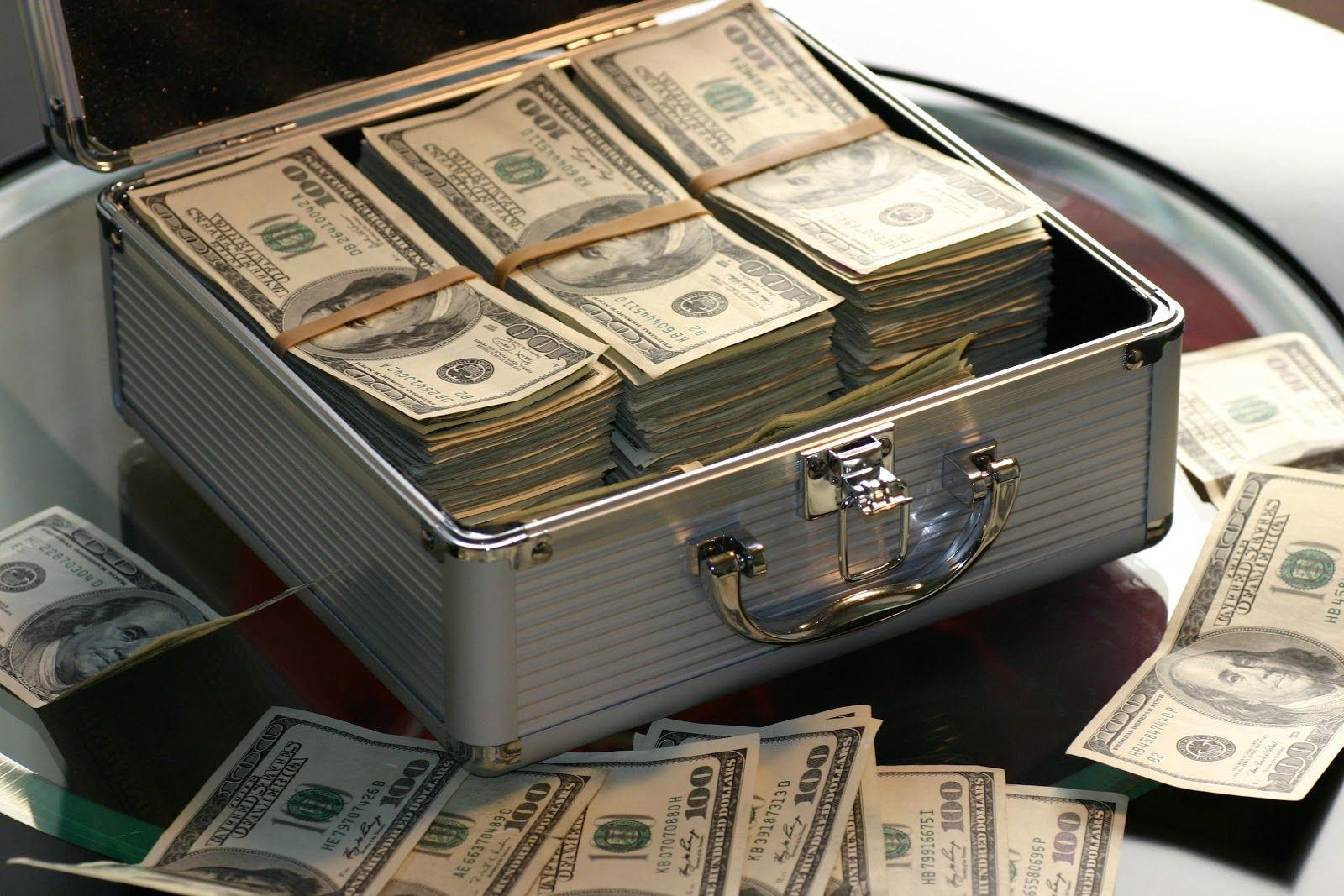 A briefcase overflowing with cash
