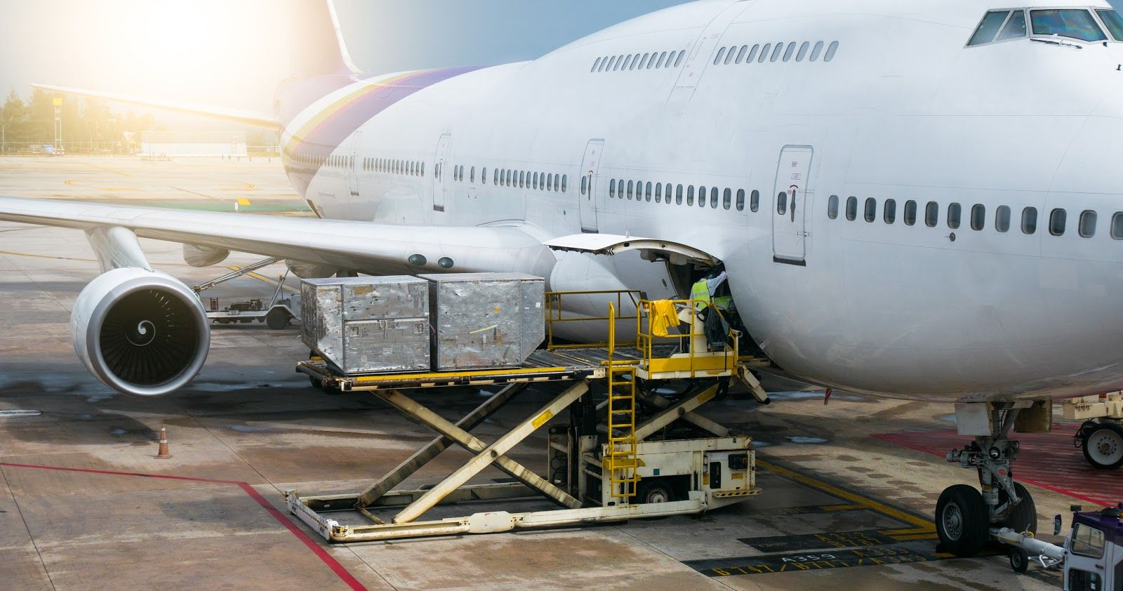 Cargo being loaded onto a cargo plane for International Shipping
